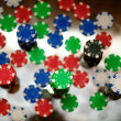 Stock Photo: Red, blue, green and black casino tokens
