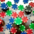 Red, blue, green and black casino tokens — Stock Photo