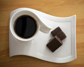 Cup of coffee with chocolate cake — Stock Photo