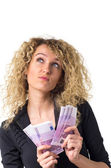 Business woman counts money and dreaming — Stock Photo