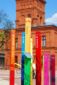 Colorful information posts in Manufactura (Lodz) — Stock Photo