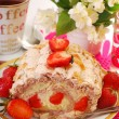 Meringue swiss roll with strawberry and almonds - Stock Photo