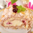 Meringue swiss roll with cherry and almonds — Stock Photo