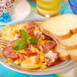 Scrambled eggs with sausage — Stock Photo