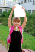 Happy schoolgirl with graduation certificate — Stock Photo