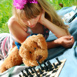 Young girl playing chess — Stock Photo