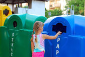 Little girl and recycling — Stok fotoğraf