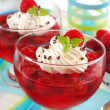Jelly dessert with raspberry and whipped cream — Stock Photo