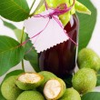 Stock Photo: Fresh green walnuts and liqueur