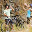 Mountain bike couple drinking — Stock Photo #11355875