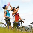 Stock Photo: Mountain bike couple drinking