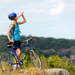Mountain bike girl drinking — Stock Photo #11355953