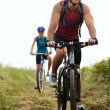Mountainbike couple outdoors — Stock Photo #11356033