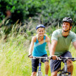 Mountainbike couple outdoors - Stock Photo