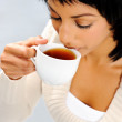 Young woman with tea — Foto de Stock