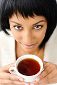 Woman looks up with cup — Stock Photo