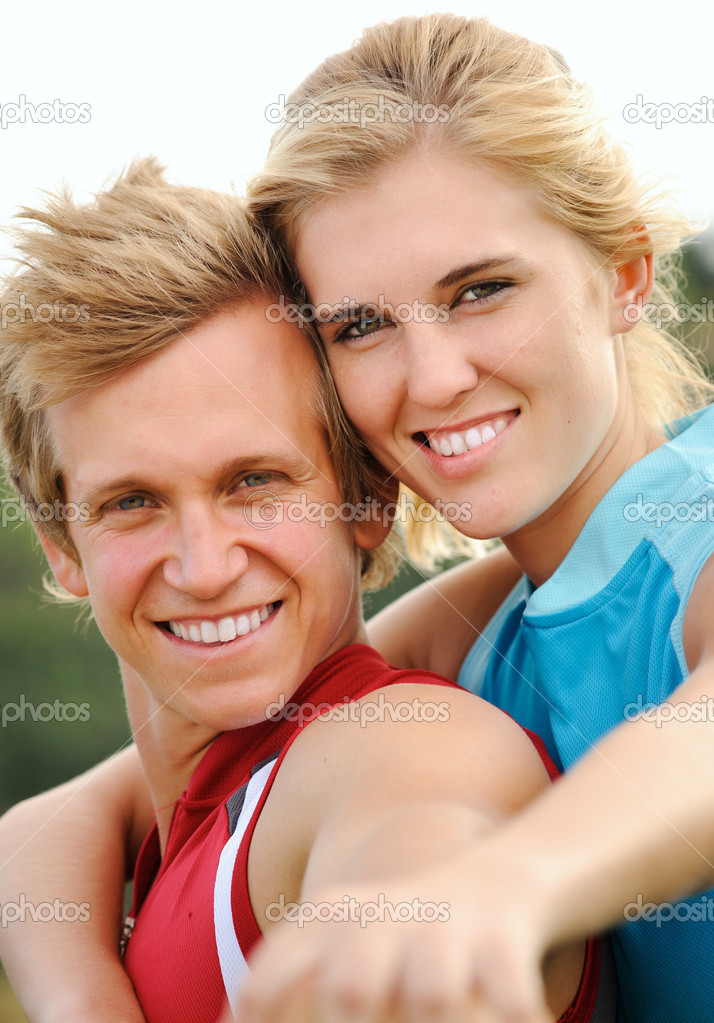 Beautiful couple posing together for a happy portrait outdoors together  Stock Photo #11356000