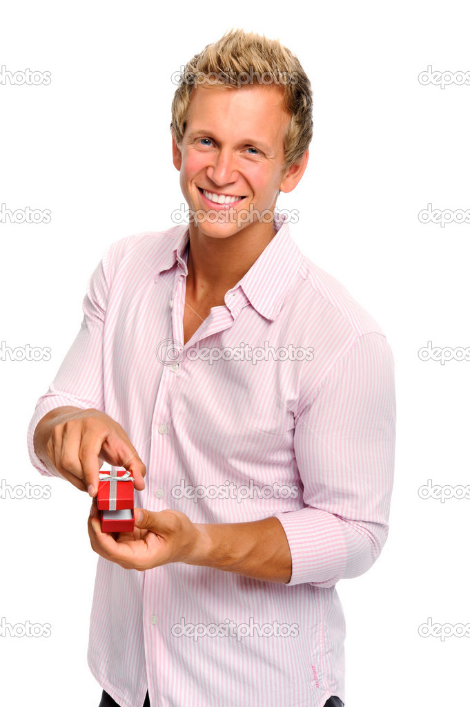 Happy blonde man holding a present for valentines day — Stock Photo #11362480