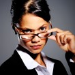 Asian woman in suit with glasses — Stock Photo #11445101