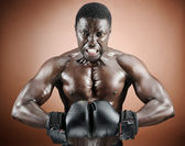 Muscular boxer with intense emotion — Stock Photo