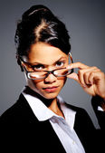 Asian woman in suit with glasses — Stock Photo