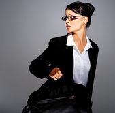 Businesswoman in suit with briefcase — Stock Photo