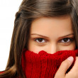 Posing woman keeps warm with coat — Stock Photo