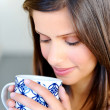 Face of woman with coffee — Stock Photo