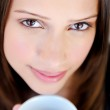 Face of woman with coffee — Stock Photo #11489705