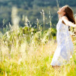 Stock Photo: Sunset dancing meadow girl
