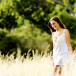 Carefree walking woman — Stock Photo