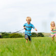 Chasing my brother and the dog in the field — Stock Photo #11490302