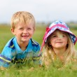 Young blond children in field — Stock Photo #11490326
