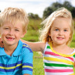 Cute young kids outdoors — Stock Photo #11490348