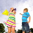 Young children having fun with their kite — Stock Photo #11490350
