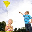 Cute blond children playing outdoors — Stock Photo #11490355