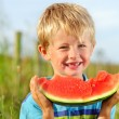 Happy boy with watermelon - 图库照片