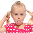 Silly little girl with pigtails - Stock Photo