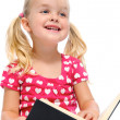 Little girl reads book and smiles — Stock Photo