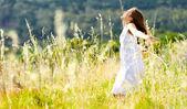 Sunset dancing meadow girl — Stock Photo