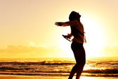 Silhouette woman beach — Stock Photo