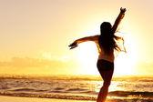 Silhouette woman beach — Stock Photo