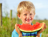 Happy boy with watermelon — Stock Photo