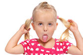 Silly little girl with pigtails — Stock Photo