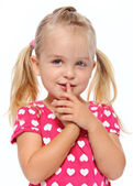 Quiet girl with finger on lips — Stock Photo