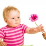 Infant girl giving flower — Stock Photo #10997164