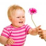 Infant girl giving flower — Stock Photo #10997168