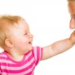 Infant baby learning to eat a biscuit — Stock Photo #10997182