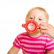 Infant baby drinking water from a bottle — Stock Photo #10997221