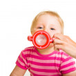 Infant baby drinking water from a bottle — Stock Photo